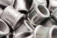 Placer connecting fittings for metal pipes. Steel castings Stock Images