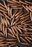 Placer copper bullets on a dark wooden background Stock Photo
