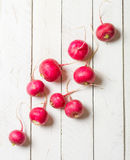 Placer of fresh red radish on a white wooden table. Place for the text. View from above Royalty Free Stock Photography