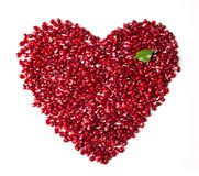 Placer garnet grains in the shape of a heart Royalty Free Stock Photos