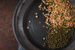 Placer lentils on a pewter plate on the table. Horizontal Stock Image