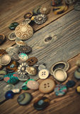 Placer of vintage buttons on aged boards Royalty Free Stock Images