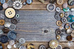Placer of vintage buttons with copy space on textured old boards Royalty Free Stock Photos