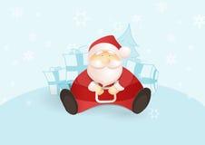 Placera jultomten med gåvor och julgranen. Arkivbild