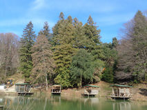 Places for fishing on the lake in the woods. Wooden huts for fishing on the lake in the forest, the nature the Caucasian Reserve Stock Photo