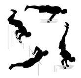 Placez avec quatre athlètes d'hommes Séance d'entraînement, concept de sport Silhouettes noires sur le fond blanc Image libre de droits