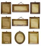 Placez de trois cadres en bois baroques d'or de cru sur le fond d'isolement photo stock