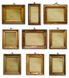 Placez de trois cadres en bois baroques d'or de cru sur le fond d'isolement photos libres de droits