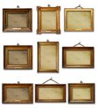 Placez de trois cadres en bois baroques d'or de cru sur le fond d'isolement photos stock