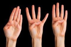 Placez des mains de femme montrant quatre doigts et paumes photographie stock