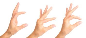 Placez des mains de femme tenant quelque chose avec deux doigts photos stock