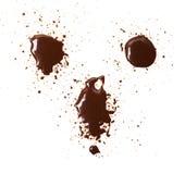 Placez du plan rapproché de taches de chocolat, d'isolement sur le fond blanc photographie stock libre de droits