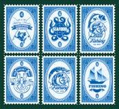 Placez le calibre des timbres avec des éléments pêchant, fruits de mer Photos libres de droits