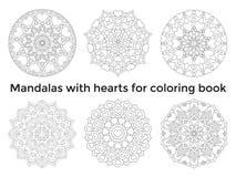 Placez les mandalas avec des coeurs Ornements circulaires symétriques de collection Images stock