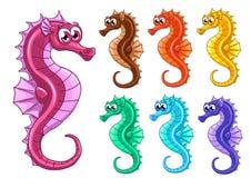 Placez sept hippocampes iridescents sur le blanc Photo stock
