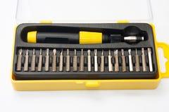 Placez un tournevis dans la boîte noire et jaune Photographie stock libre de droits