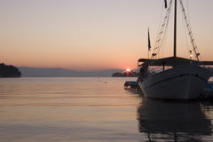 Placid Dawn. Dawn breaking over a placid sea in Corfu, Greece royalty free stock images