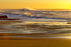 A placid early morning sunrise at Baggies Beach near Durban, South Africa Royalty Free Stock Image