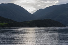 Placid Waters. The Inside Passage with calm waters and green mountains in the background Stock Photo