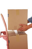 Placing Box on Hand Truck Stock Photo
