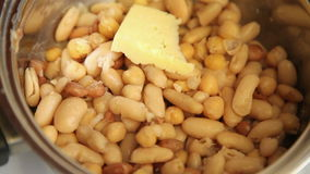 Placing cheese on boiling beans stock footage