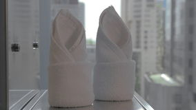 Placing clean towels in the hotel bathroom stock footage