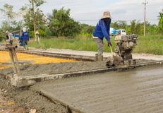 Placing concrete road construction Improve Royalty Free Stock Image
