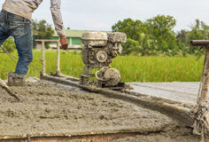 Placing concrete road construction Improve Royalty Free Stock Images