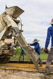 Placing concrete road construction Improve Royalty Free Stock Photos