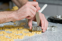 Placing cookies after cutting on backing paper Royalty Free Stock Photo
