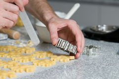 Placing cookies after cutting on backing paper Stock Image