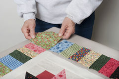 Placing cornerstone for quilt top border. Stock Photography