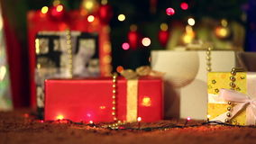 Placing a Gift under the Christmas tree. Dolly movement stock video footage