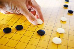 Placing Go Stone Stock Photography