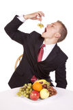 Placing grapes in mouth Royalty Free Stock Photo