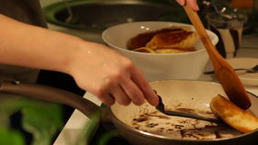 Placing homemade cakes in the pan for frying stock footage
