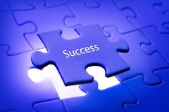 Placing last piece of jigsaw puzzle Royalty Free Stock Images