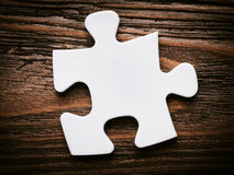 Placing missing a piece of puzzle. business concept. Royalty Free Stock Photo