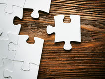 Placing missing a piece of puzzle. business concept. Stock Image