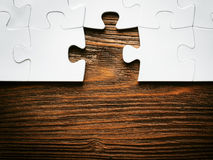 Placing missing a piece of puzzle. business concept. Stock Photography