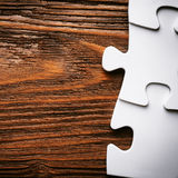 Placing missing a piece of puzzle. business concept. Royalty Free Stock Images