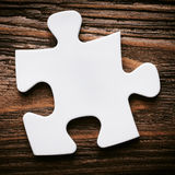 Placing missing a piece of puzzle. business concept. Royalty Free Stock Photography