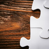Placing missing a piece of puzzle. business concept. Royalty Free Stock Image