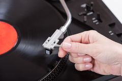 Placing the needle on a record Stock Photo