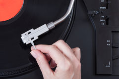 Placing the needle on a record Stock Images