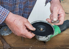 Placing Sanding Disk Holder onto Fastening Bolt of Angle Grinder. Stock Image