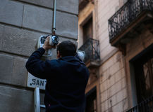 Placing security cameras on a main avenue in Barcelona Stock Photo