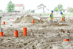 Placing set of new plastic sewer pipes into the ground Royalty Free Stock Image