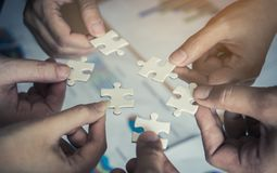 Placing six puzzles jigsaw together for team concept Stock Images
