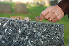 Placing Stone On Tombstone Royalty Free Stock Image